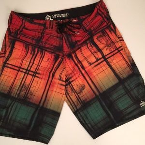 REEF SURFING SHORTS. Size 36. Multi-Color. Pocket.